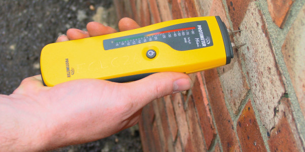 Damp Proofing Service from North West Electrical using a moisture meter