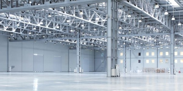Inside of an industrial unit showcasing a commercial electrical installation from North West Electrical with 80 hanging decorative halogen lamps